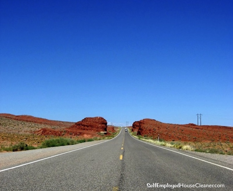 Your business tax journey on the open road with red hills and blue sky.