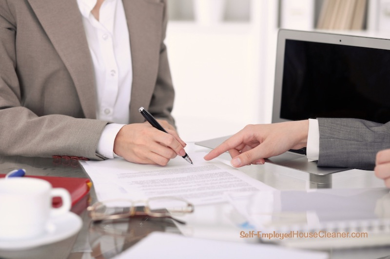 Cleaning business owner ready to sign business papers.