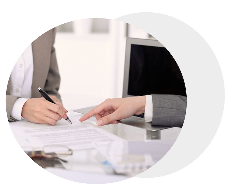 Two people ready to sign start-up paperwork